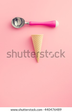 wafer cone and ice cream scoop on pink background