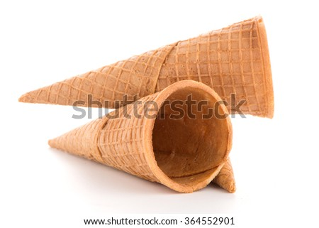 Wafer cones on white background. - stock photo