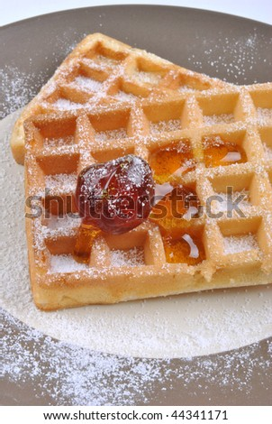 wafer with icing sugar and one cherry
