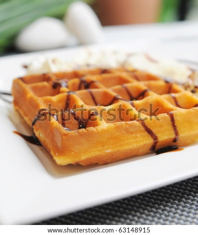 Waffle on top with chocolate and banana. Capture with wide aperture - stock photo