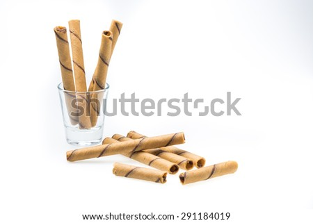 Waffle rolls flavored coffee in glass cups.