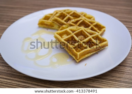 waffle with honey in white plate, Selective Focus