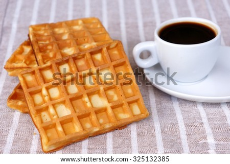 Waffles and a cup of coffee - stock photo
