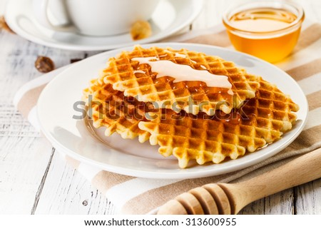 waffles and coffee on white wooden table - stock photo
