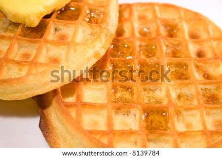 Waffles in dish with syrup for breakfast - stock photo