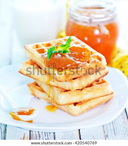 waffles with apricot jam on the plate