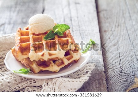 Waffles with banana and nuts honey, rustic wood background, toned - stock photo