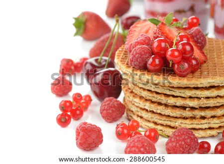 Waffles with berries on a white background - stock photo