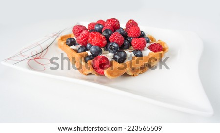 waffles with blueberries and raspberries - stock photo