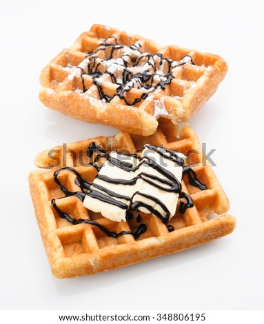 waffles with butter and chocolate isolated on white