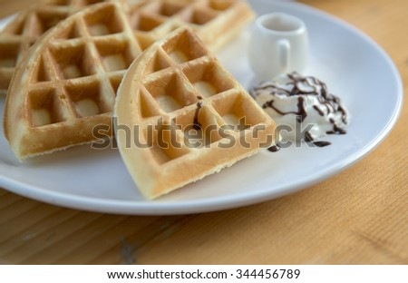 Waffles with butter and honey sauce
