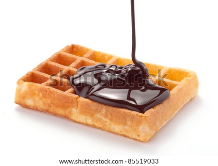 Waffles with melted chocolate - stock photo