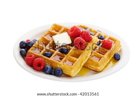 Waffles with mixed fruit and maple syrup - stock photo