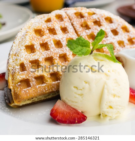 Waffles with strawberries with ice cream. Extra honey on white plate. - stock photo