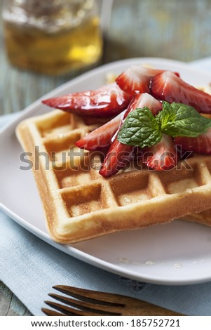 Waffles with strawberry and honey