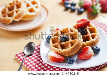 waffles with strawberry , blueberry and caramel sauce - stock photo
