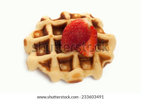 Waffles with strawberry on white background