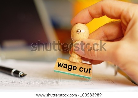 wage cut concept with stamp in office or bureau showing financial crisis - stock photo