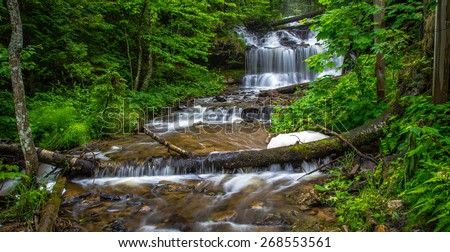 Wagner Falls. Beautiful Wagner Falls Scenic Site on the outskirts of Munising in Michigan's Upper Peninsula. - stock photo