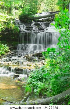 Wagner Falls cascade in Munising Upper Peninsula, Michigan - stock photo