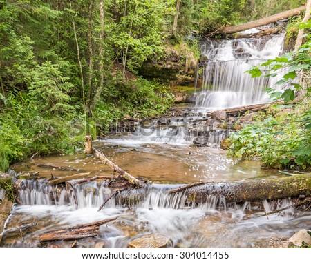 Wagner Falls on Wagner Creek, in Wagner Falls State Park, near Munising, Michigan. - stock photo