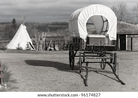 Wagon and wigwam, traditional articles of ancient American country - stock photo