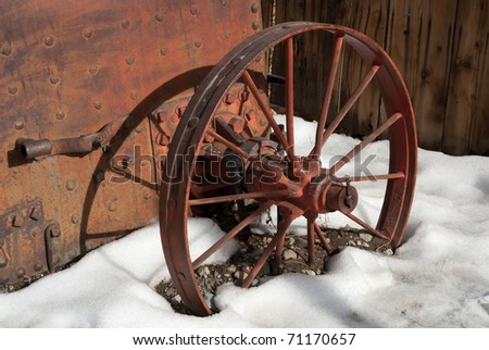 Wagon Wheel in the Snow at Virginia City, Nevada - stock photo