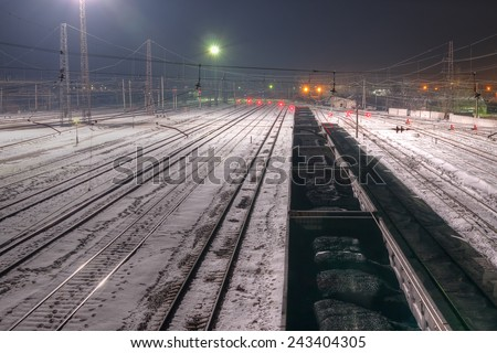 Wagons loaded with coal at the station are winter night. - stock photo