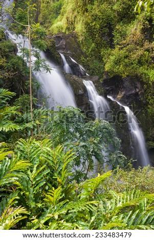 Waikani Falls, in lush jungle, on the road to Hana, Maui, Hawaii - stock photo