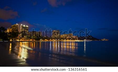 Waikiki beach at night, Honolulu Hawaii - stock photo