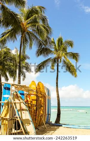 WAIKIKI BEACH, HONOLULU, HAWAII - July 17, 2014. Surfboard rack on the ocean shore in Waikiki Beach, Honolulu - stock photo