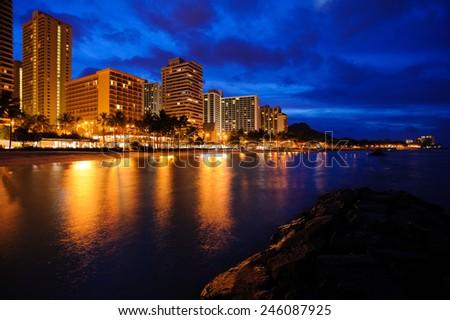 Waikiki beach in Honolulu Hawaii before sunrise - stock photo
