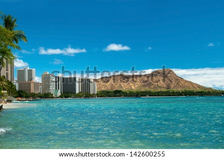 Waikiki beach with azure water in Hawaii with Diamond Head in background. - stock photo