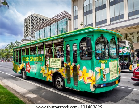 WAIKIKI, HAWAII - APRIL 25: Hilo Hattie's bus on Kalakaua avenue in Waikiki on April 25, 2014. The Hilo Hattie's shuttle is a free shuttle from Waikiki to the famous Hilo Hattie's store in Honolulu. - stock photo