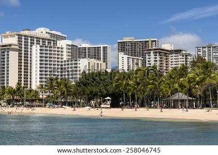 WAIKIKI, HAWAII - FEBRUARY 18, 2015: View of hotels at Waikiki beach in Honolulu, Hawaii. Waikiki white sand beach shoreline is Hawaii's most famous beach. - stock photo