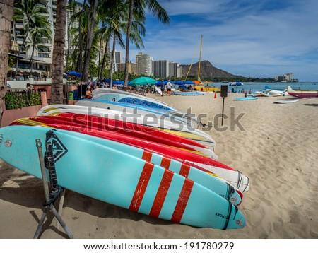 WAIKIKI, HI - APRIL 29 - Surfboard rentals waiting for tourists on Waikiki beach on April 29, 2014 in Oahu. Waikiki beach is beachfront neighborhood of Honolulu, best known for white sand and surfing. - stock photo
