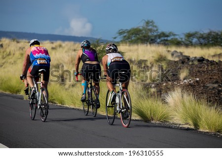 WAIKOLOA, USA - APRIL 3, 2011: Unidentified cyclers on the Lavaman Triathlon in Waikoloa, Hawaii. It is held in Olympics format: 1.5 km swimming, 40 km biking and 10 km running.