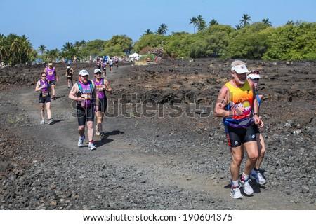 WAIKOLOA, USA - APRIL 3, 2011: Unidentified runners on the Lavaman Triathlon in Waikoloa, Hawaii. It is held in Olympics format: 1.5 km swimming, 40 km biking and 10 km running. - stock photo