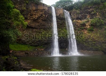 Wailua falls Kauai with people as a scale - stock photo