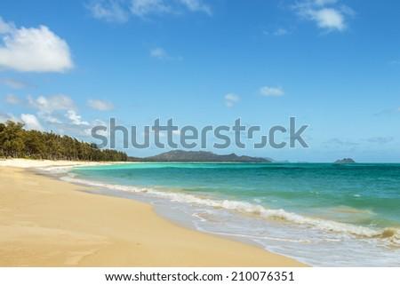 Waimanalo Beach looking north towards Bellows beach and the Koolau mountain range on Windward Oahu, Hawaii - stock photo