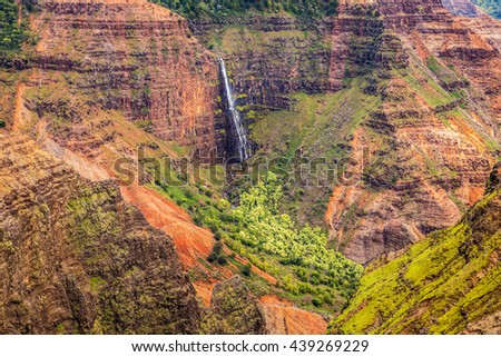 Waipoo Falls in the colorful Waimea Canyon on the island of Kauai, Hawaii - stock photo