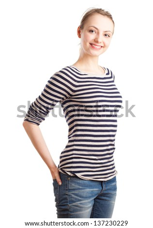Waist up portrait of an European blond woman in her twenties in striped pullover. Isolated on white background.