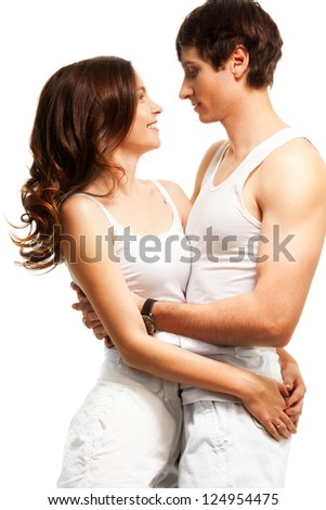 Waist up portrait of beautiful couple hugging, smiling and looking into each others eyes - stock photo