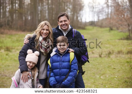 Waist up portrait of family together in the countryside - stock photo