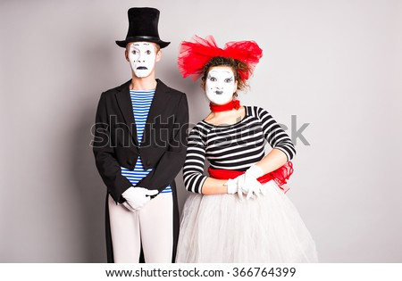 Waist-up portrait of funny mime couple with white faces. The concept of Valentine's Day, April Fool's Day - stock photo