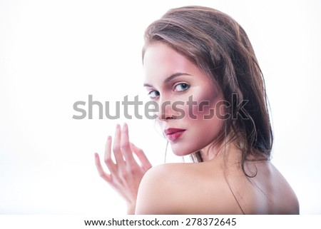 Waist-up portrait . Sensual look from the back of a beautiful girl. isolated on white background - stock photo