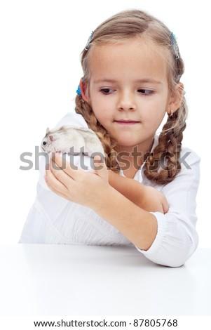 Wait you little devil - little girl catching her runaway hamster - stock photo