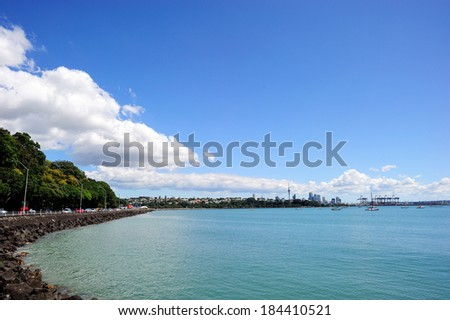 Waitemata Harbour with the Sky Tower seen from the north shore city, Auckland, New Zealand - stock photo