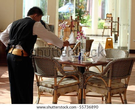 waiter at work - stock photo