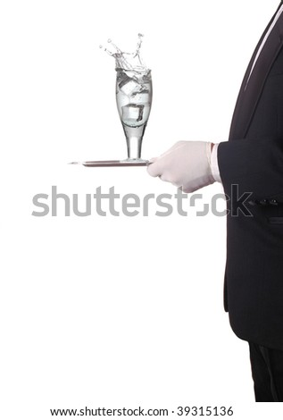 Waiter Carrying a tray with a glass with Splash of water. Vertical Composition, torso only isolated on white. - stock photo
